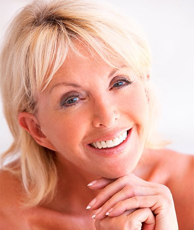 Middle aged woman smiling after teeth polishing