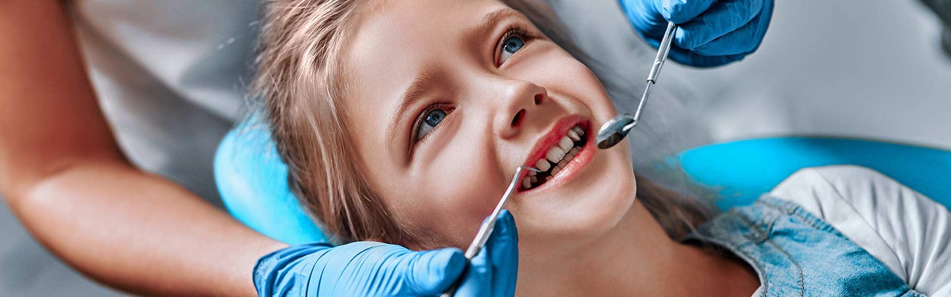 Child smiling during dental check up