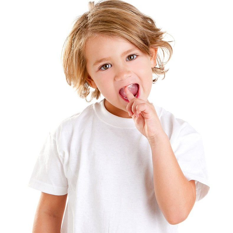 Smiling child with finger in its mouth