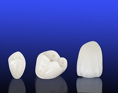 Dental crowns on blue background
