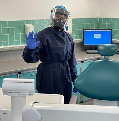 Parkhill Dentist in full PPE waving