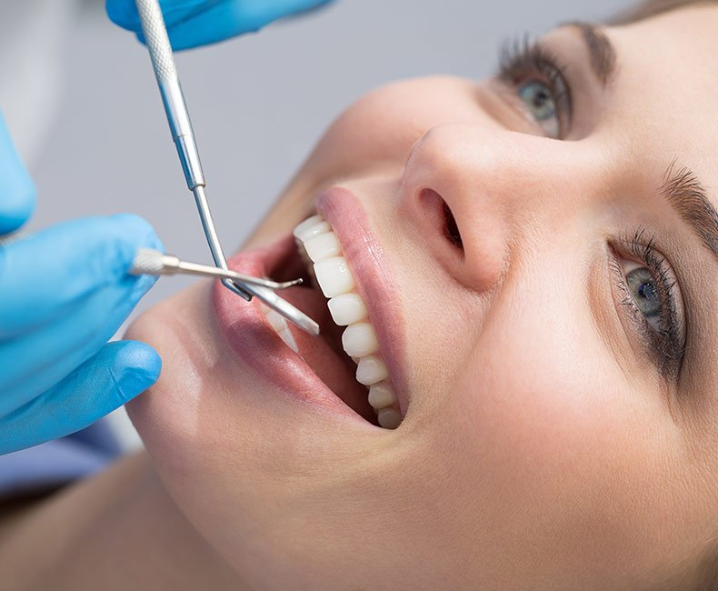 Woman smiling as she has advanced dentistry