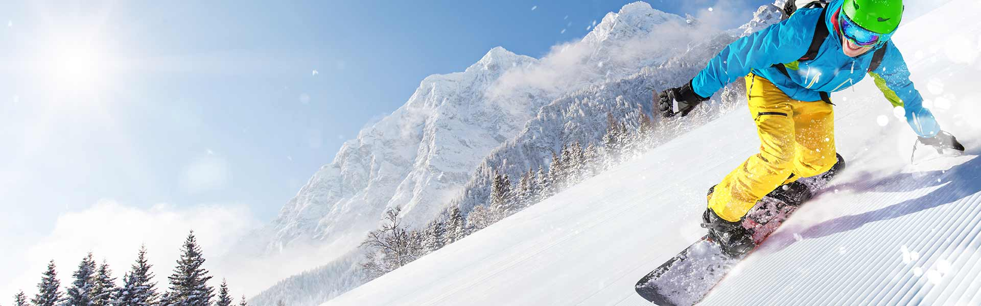 Snowboarder skiing down a ski slope