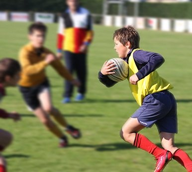 Boys playing contact sports wearing mouth guards