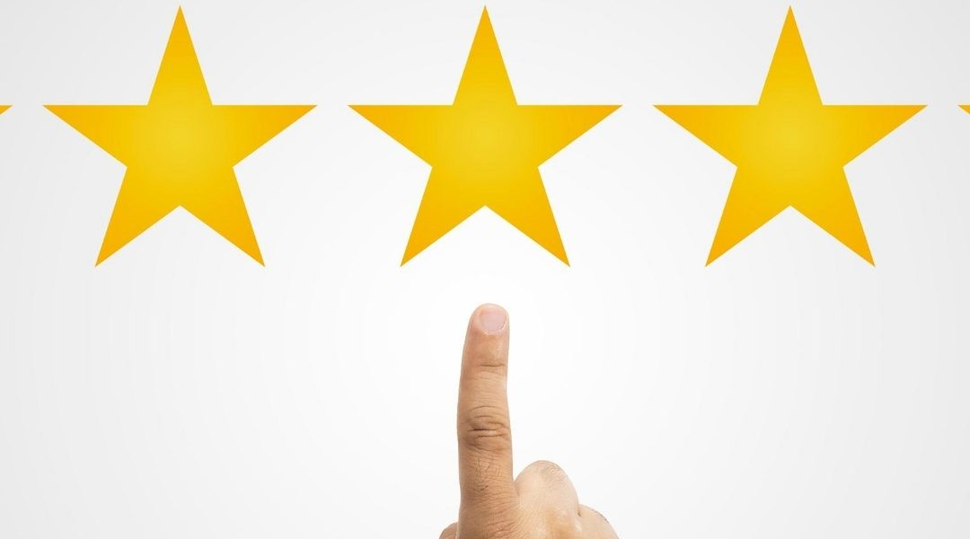 Finger pointing to 5 gold stars